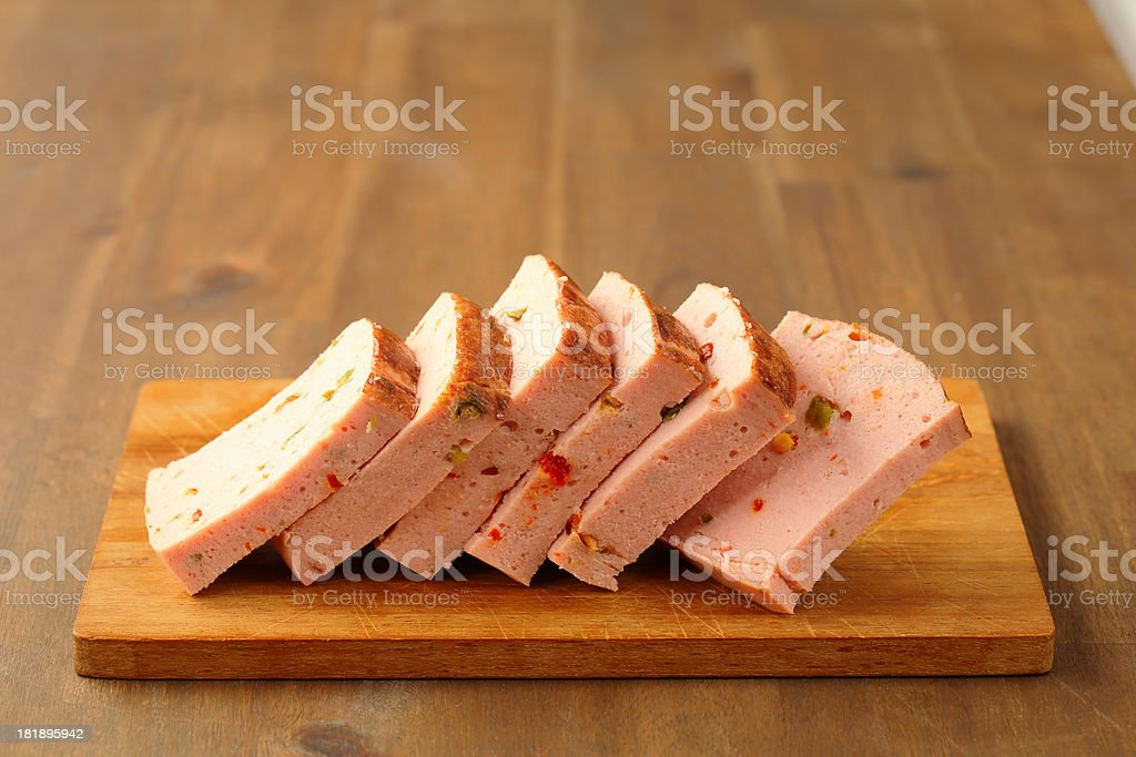 Slices of delicious liver pate on a cutting board stock photo