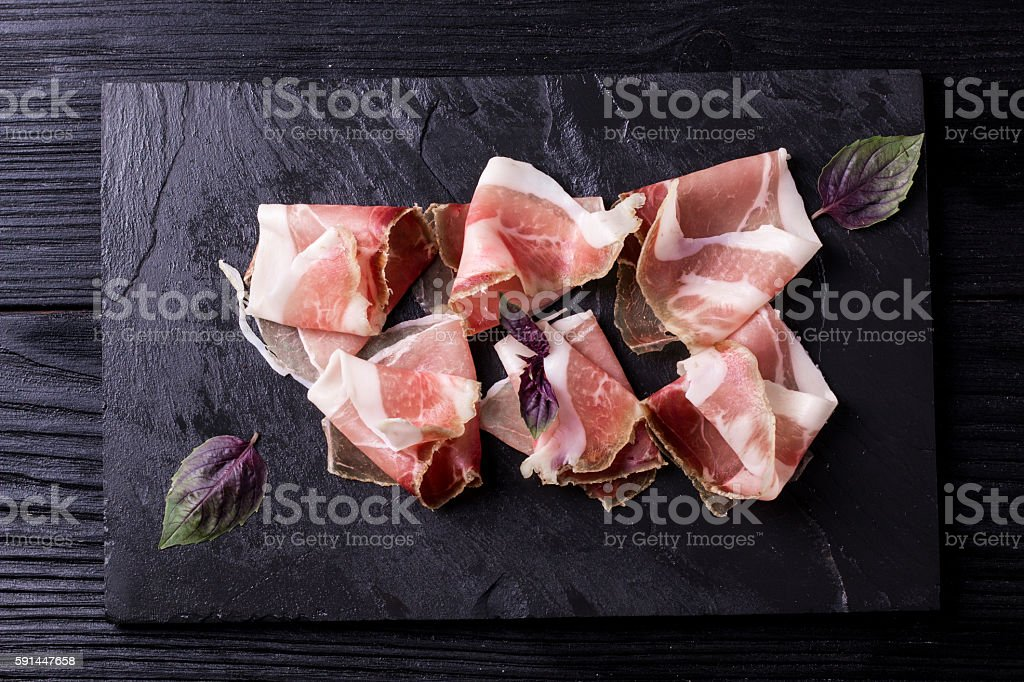 Slices of Delicious Prosciutto with spice  Italian and Mediterranean cuisine stock photo