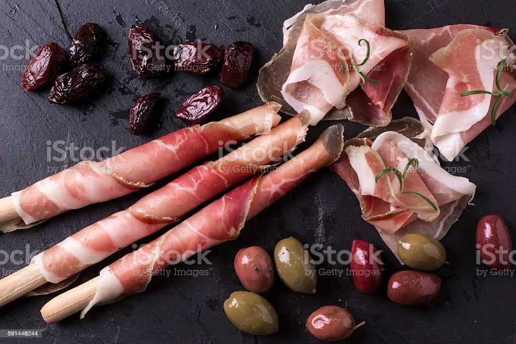 Slices of Delicious Prosciutto with spice  Italian and Mediterranean cuisine stock photo