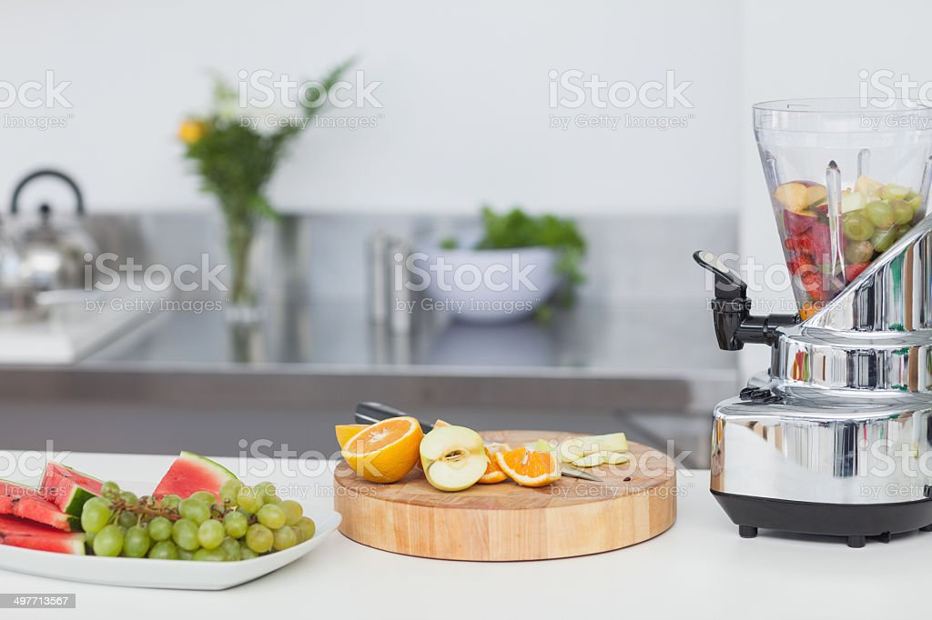Slices of different fruits for a fruit cocktail stock photo