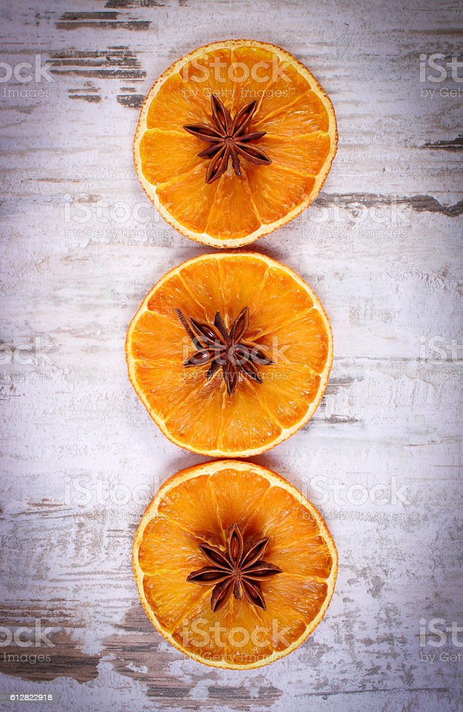 Slices of dried orange and star anise on stock photo