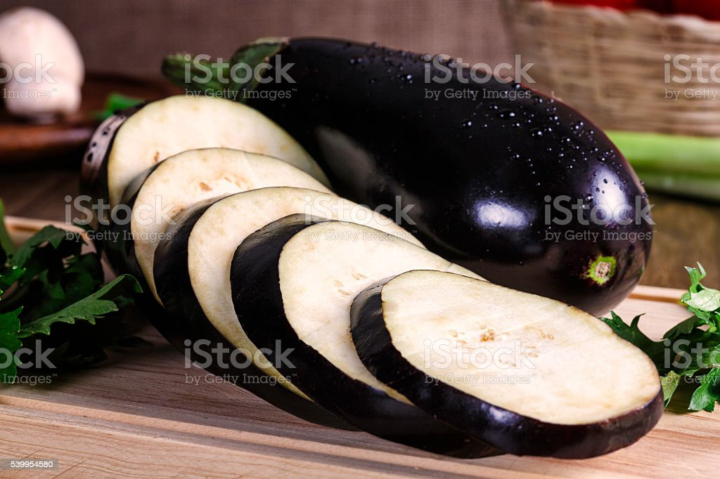 Slices of eggplant on cutting board ready to grill stock photo