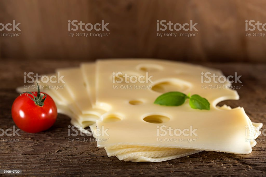 Slices of Emmental cheese stock photo