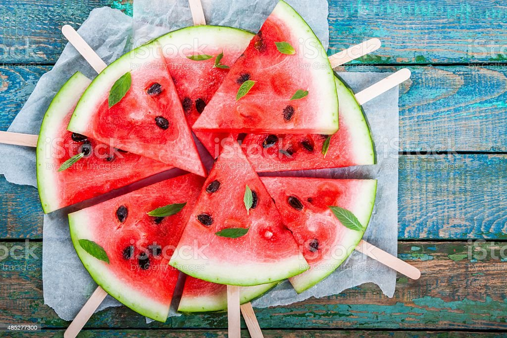 Slices of fresh juicy watermelon on a paper closeup stock photo