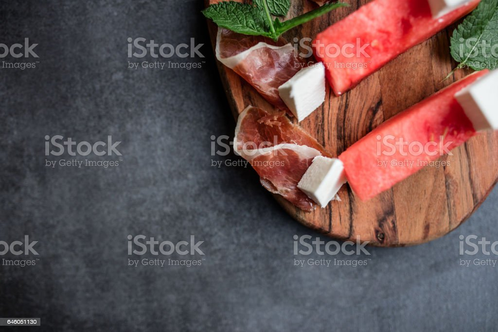 Slices of fresh watermelon in a plate with feta cheese stock photo
