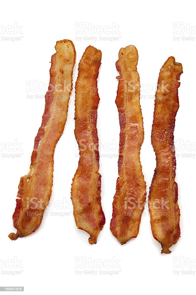 Slices of fried bacon on white stock photo