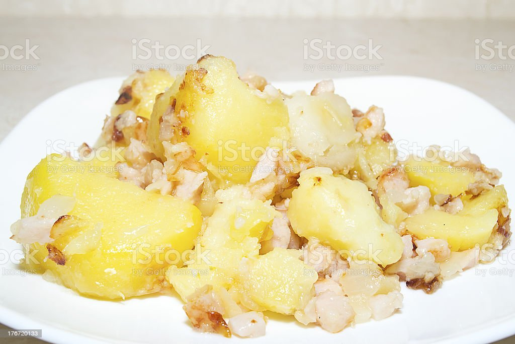 slices of fried potato  with pork royalty-free stock photo