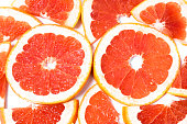 Slices of grapefruit on a white background
