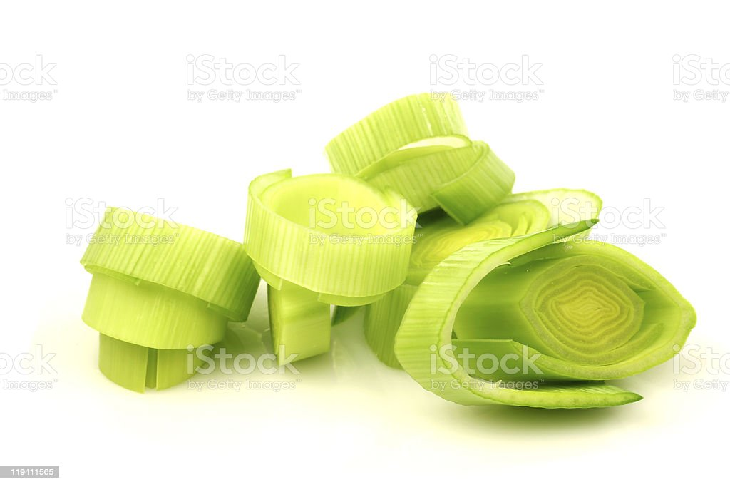 Slices of green freshly cut leeks isolated on white stock photo