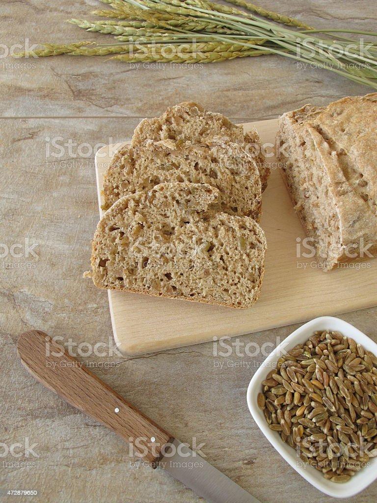 Slices of green spelt bread stock photo