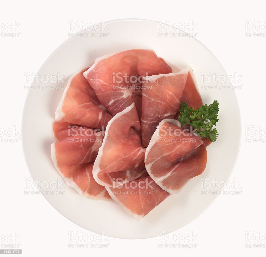 Slices of ham in dish stock photo