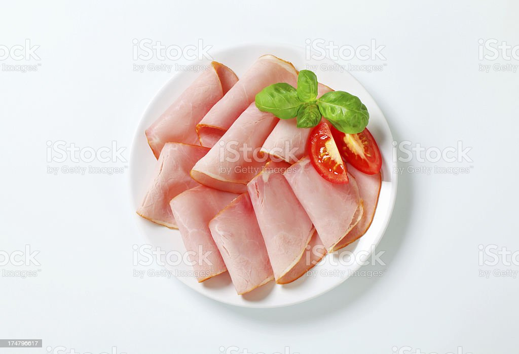 Slices of ham with basil and tomato royalty-free stock photo