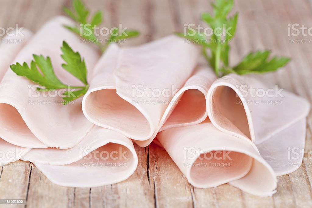 slices of ham with parsley stock photo