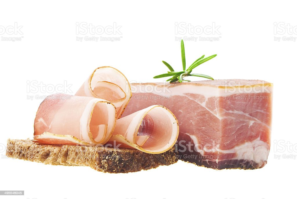 Slices of ham with rosemary royalty-free stock photo