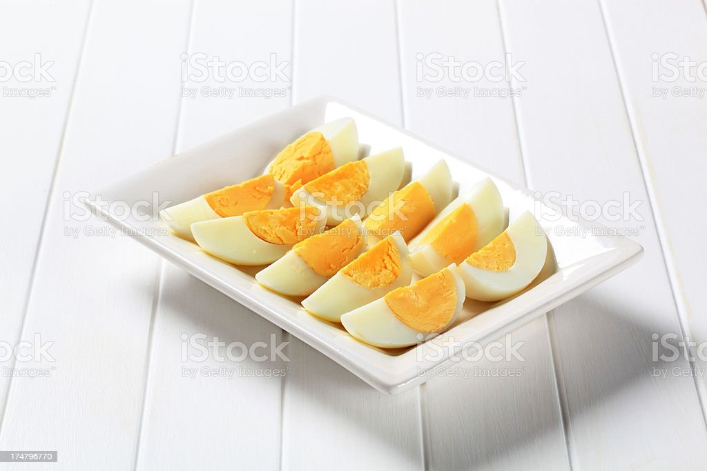 Slices of hardboiled eggs royalty-free stock photo