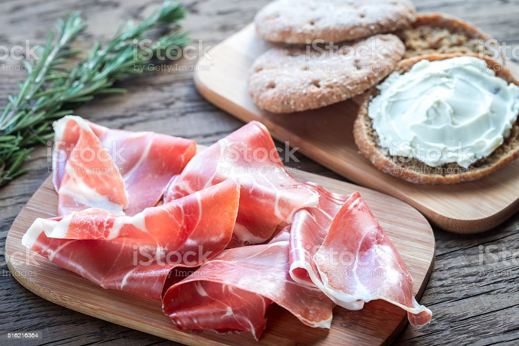 Slices of jamon and sandwich with cream cheese stock photo