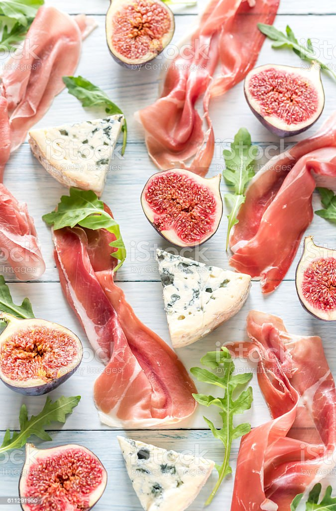 Slices of jamon with blue cheese and figs stock photo