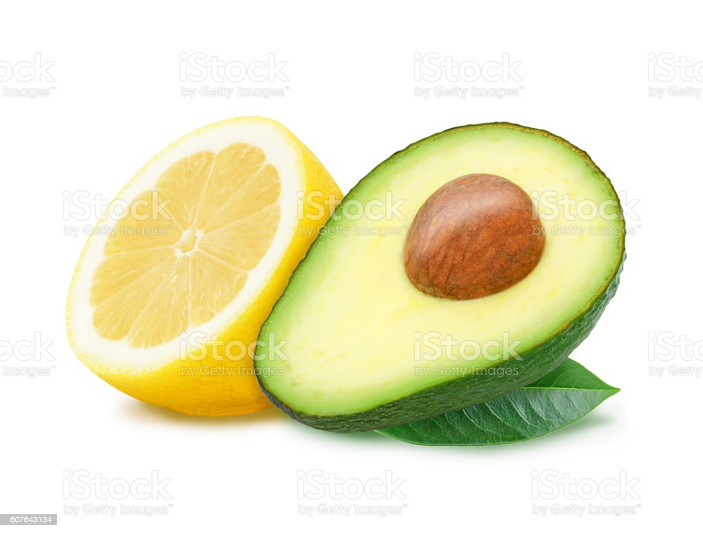 Slices of lemon and avocado with leaves. stock photo