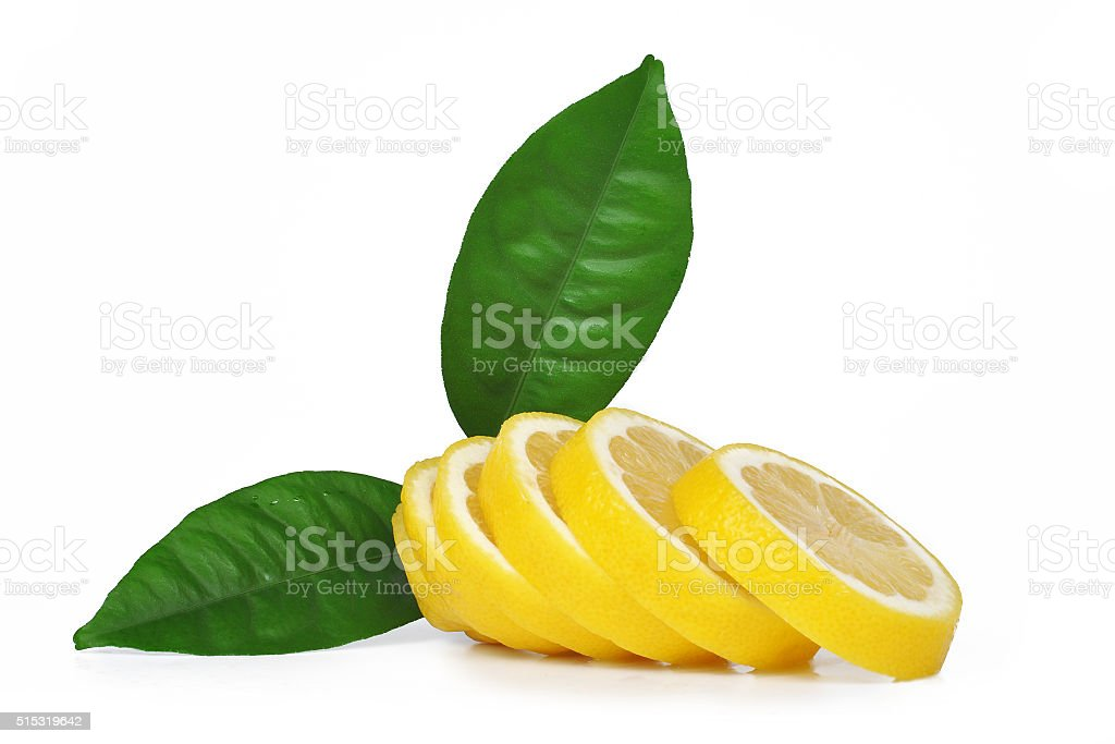 Slices of lemon with green leaves stock photo
