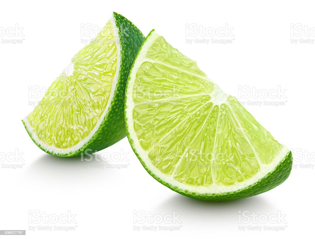Slices of lime citrus fruit isolated on white stock photo