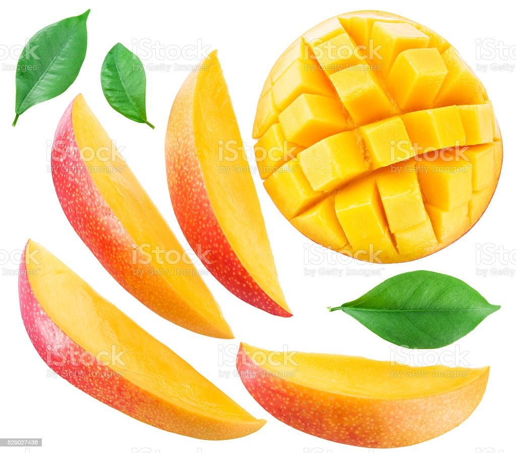 Slices of mango fruit and leaves over white. stock photo