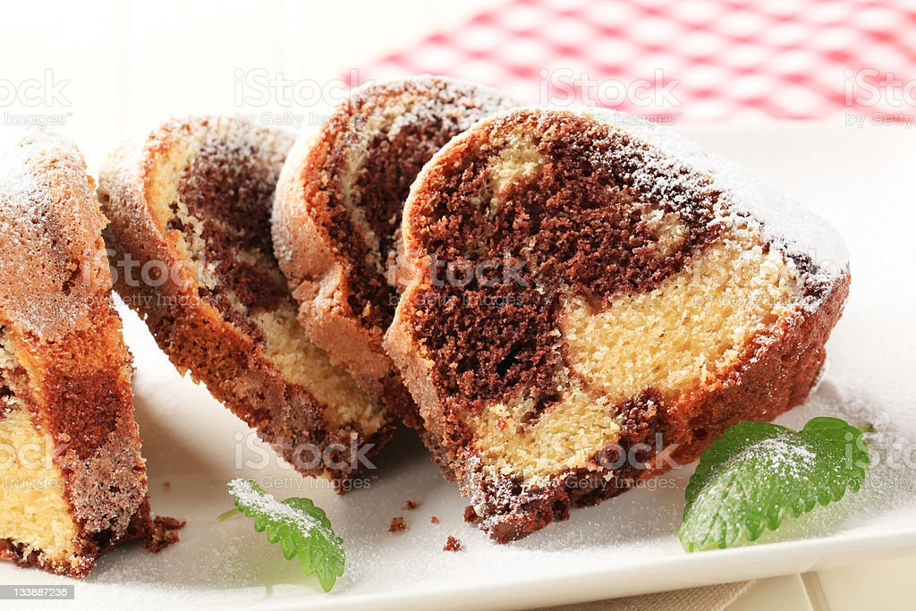 Slices of marble cake topped with powder sugar stock photo