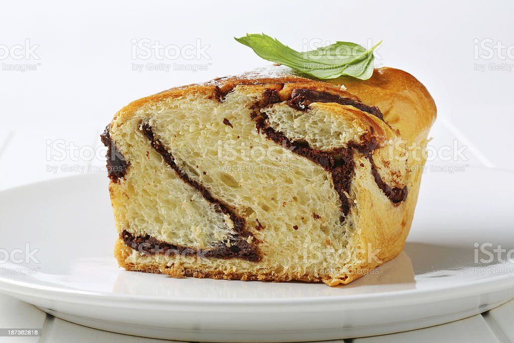 Slices of marble cake with chocolate glaze stock photo