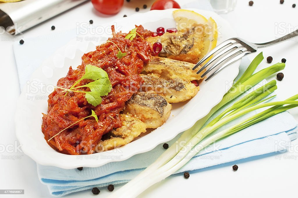 Slices of marinated grilled fish, on oval plate. royalty-free stock photo