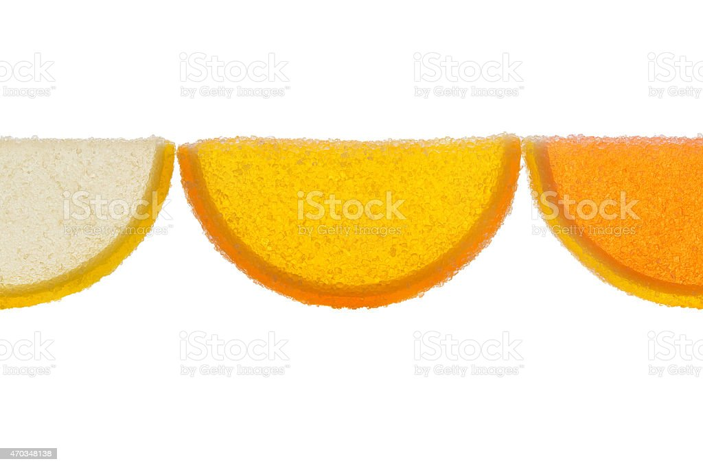 Slices Of Marmalade Illuminated From Behind On A White Background. stock photo