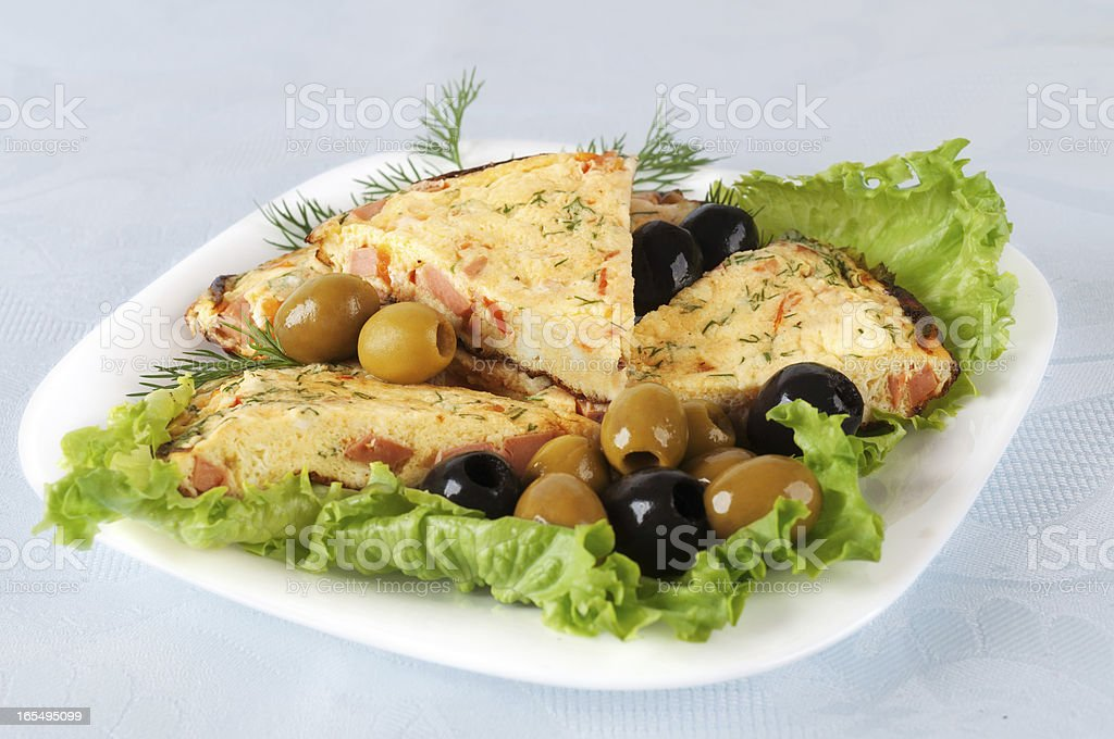 Slices of omelette on a plate royalty-free stock photo