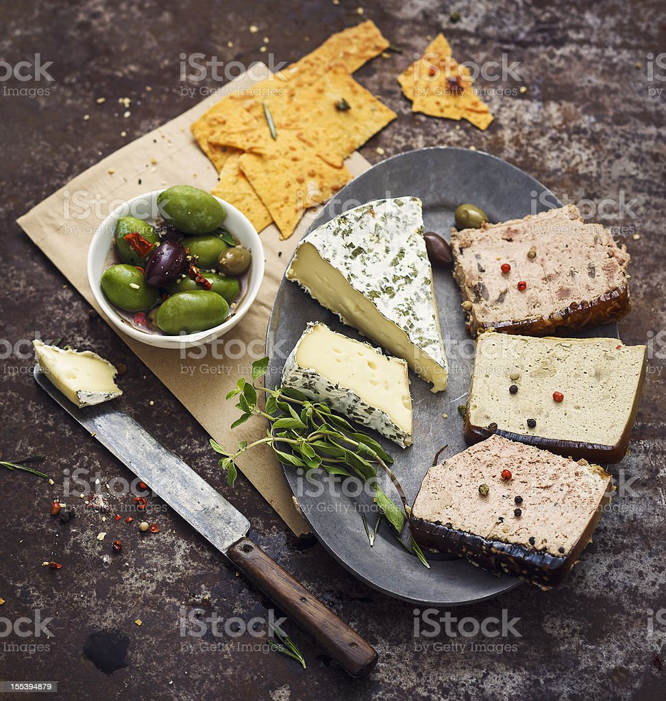 Slices of Pate and Brie Cheese stock photo