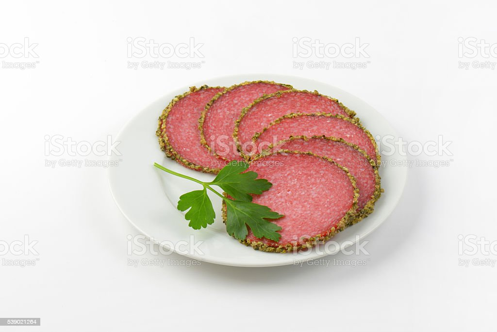 slices of pepper coated salami stock photo