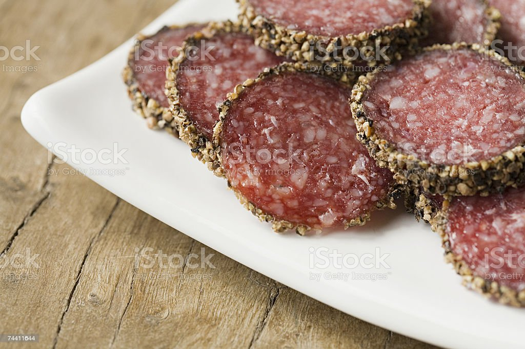 Slices of pepperoni sausage stock photo