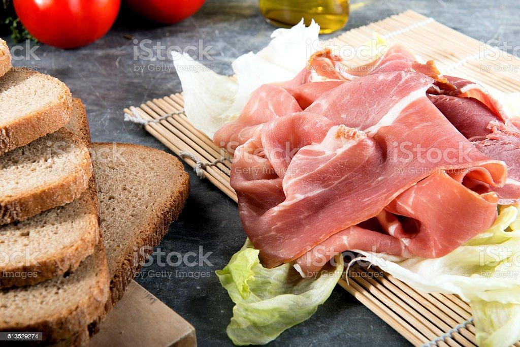 slices of prosciutto di parma stock photo