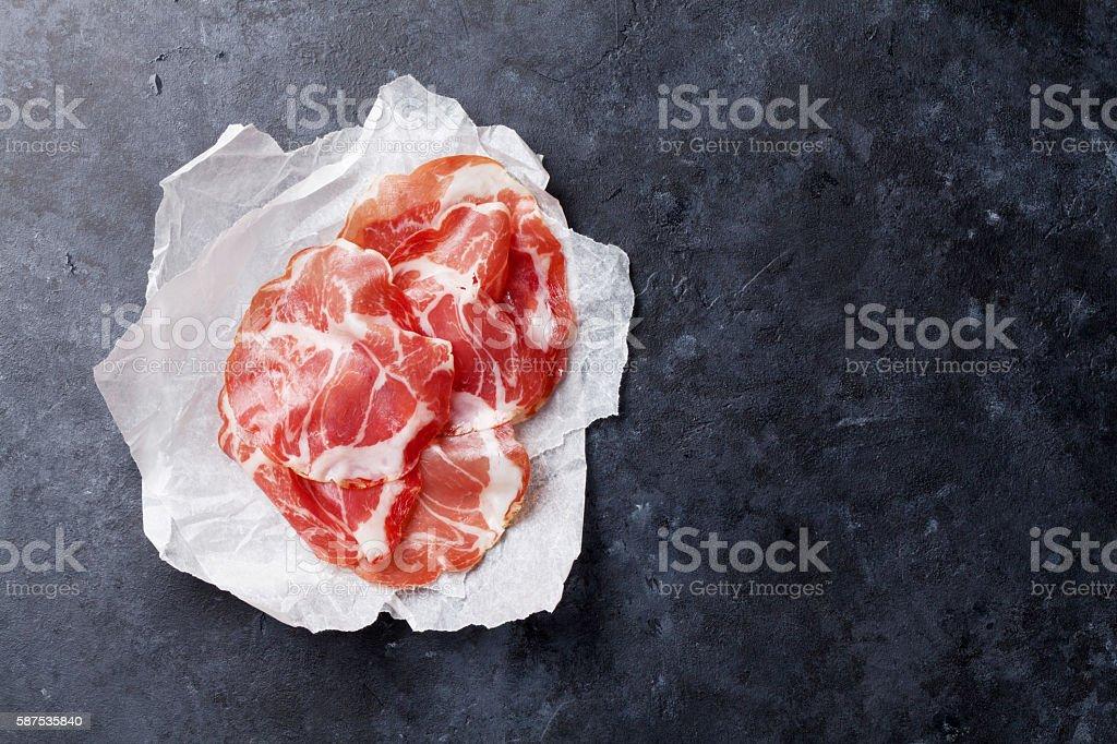 Slices of prosciutto stock photo
