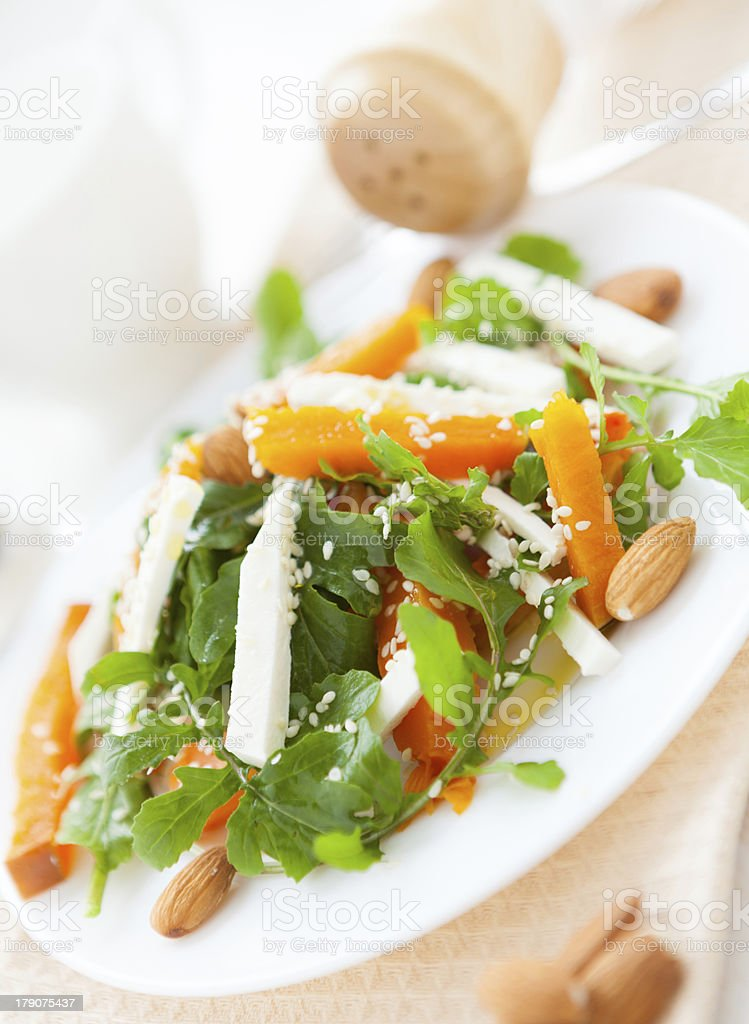 slices of pumpkin and feta on a white plate royalty-free stock photo