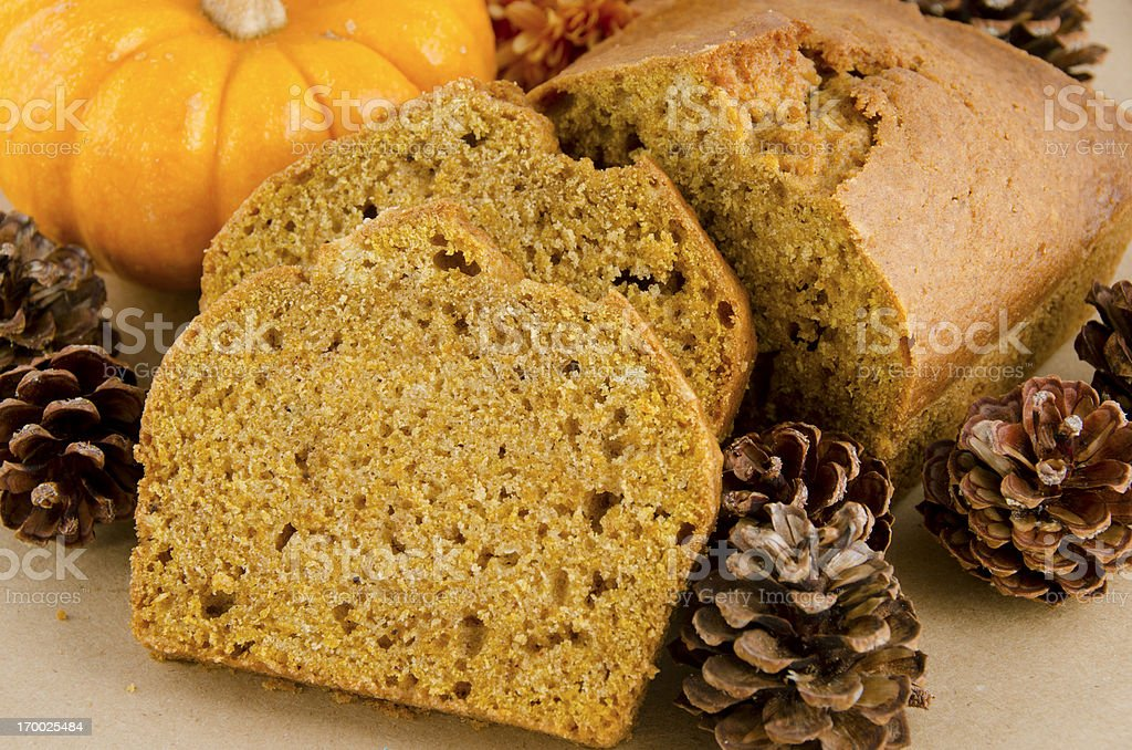 slices of pumpkin bread surrounded by pinecones royalty-free stock photo