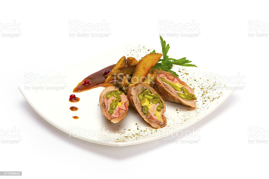 Slices of rare Beef Wellington on the serving dish stock photo