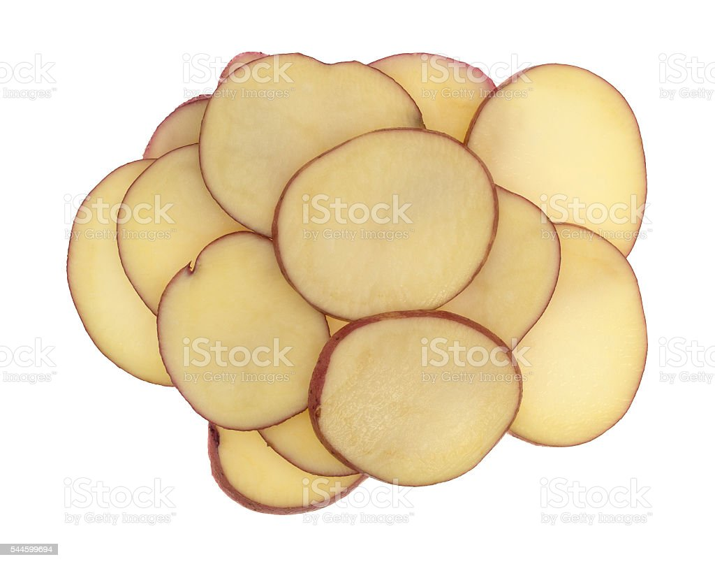 Slices of red potatoes on a white background. stock photo