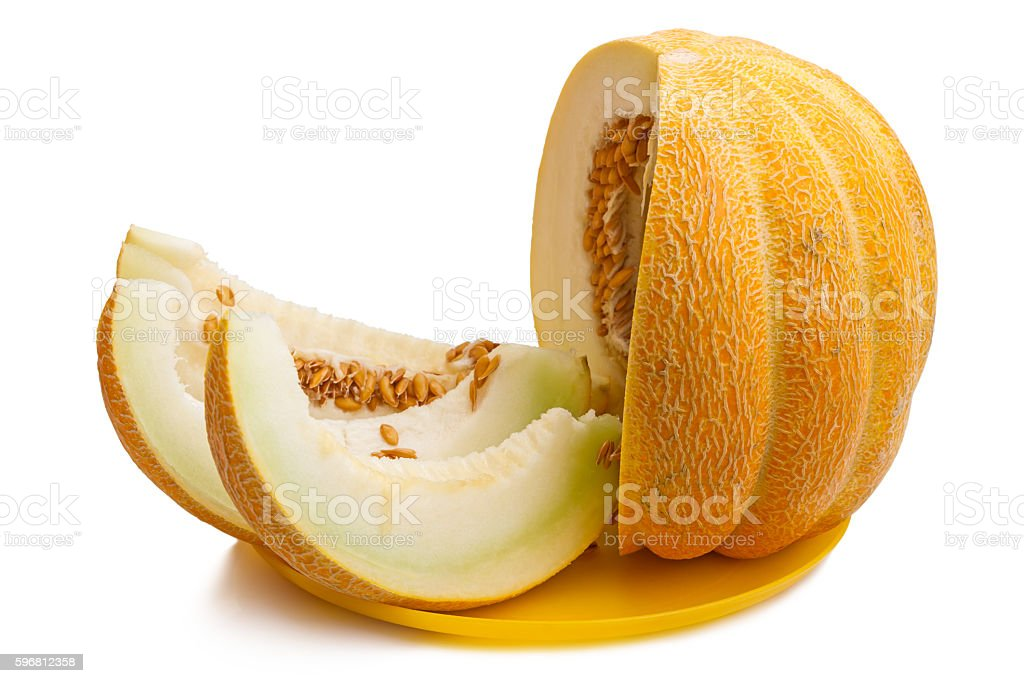 Slices of ripe melon on a yellow plate stock photo