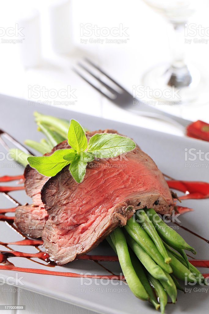 Slices of roast beef and string beans royalty-free stock photo