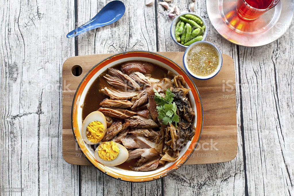 slices of roast pork trotters stock photo