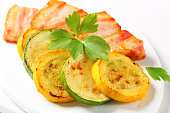 Slices of roasted pork nech with zucchini