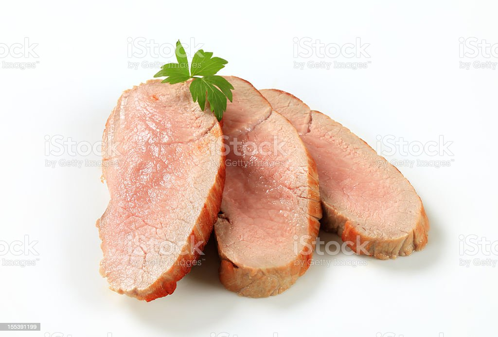 Slices of roasted pork placed on a white background stock photo