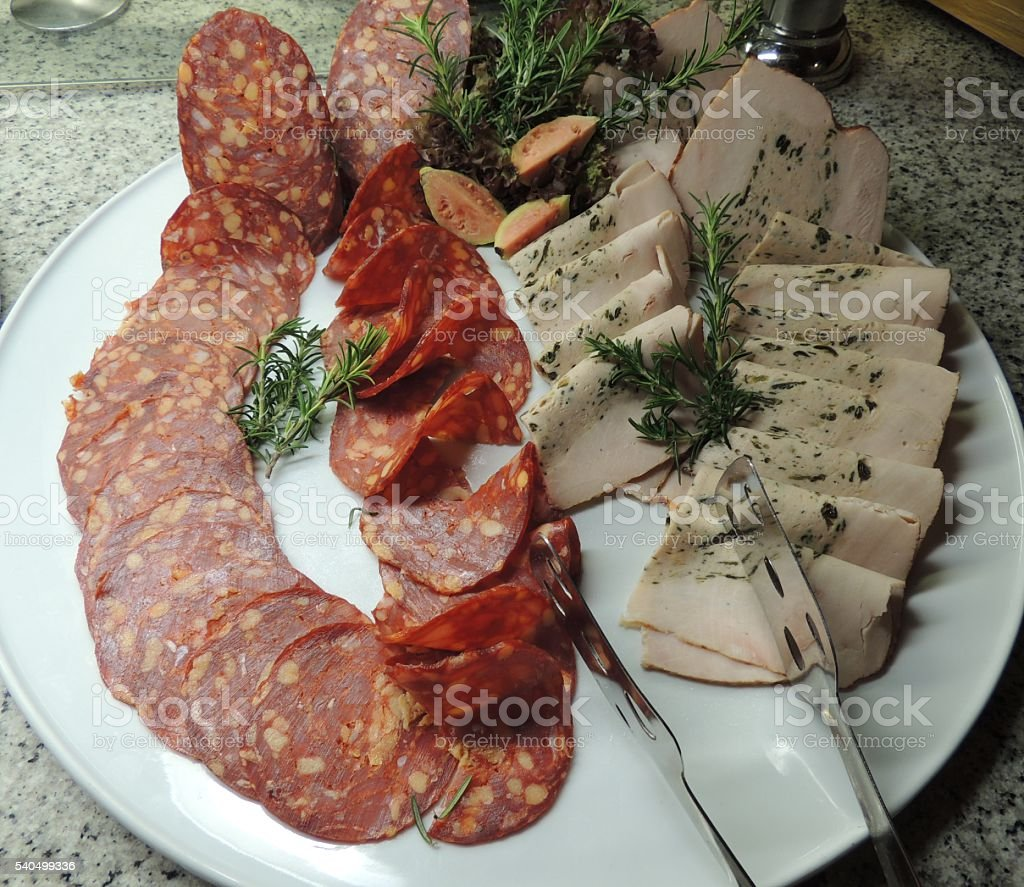 Slices of Salami and Stuffed Turkey Breast stock photo