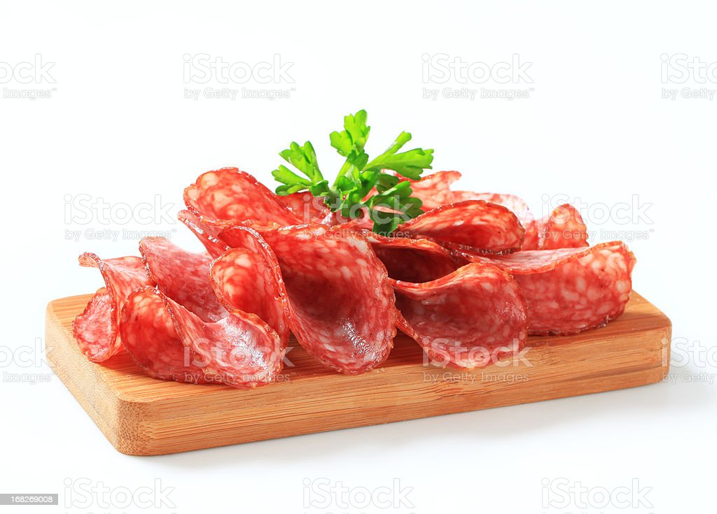 Slices of salami on a cutting board royalty-free stock photo