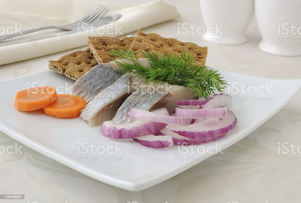 Slices of salted herring with onions royalty-free stock photo