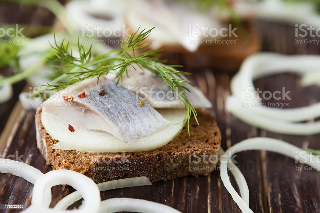 slices of salty herring on whole grain bread with dill royalty-free stock photo