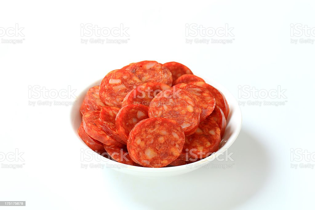 Slices of sausage in a bowl royalty-free stock photo