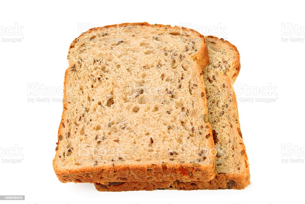 Slices of seeded brown bread on white background stock photo